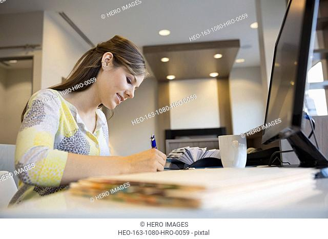 Receptionist working at front desk in dentists office