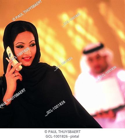 Arab woman using cell phone