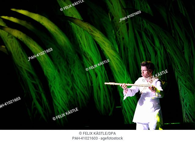 Actors perform the Mozart opera 'The Magic Flute' as photo rehearsal on the floating stage (Seebuehne) in Bregenz, Germany, 12 July 2013