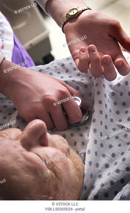 Nurse giving senior woman a checkup