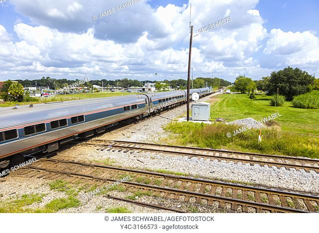 Passenger train on tracks at track intersection at the Union Station Depot and Train Veiwing Platform in Plant City Florida in the United States
