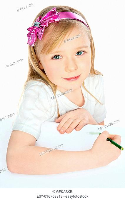 kid girl drawing with green pencils