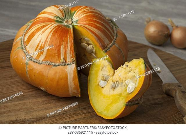 Fresh heirloom orange Turban squash and slice