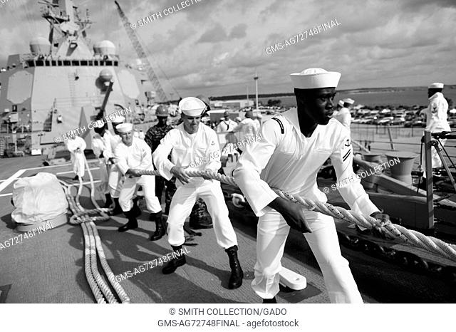 Sailors aboard the guided-missile destroyer USS Farragut DDG 99 heave in lines before getting underway, Mayport, Florida, 2012. Image courtesy U.S