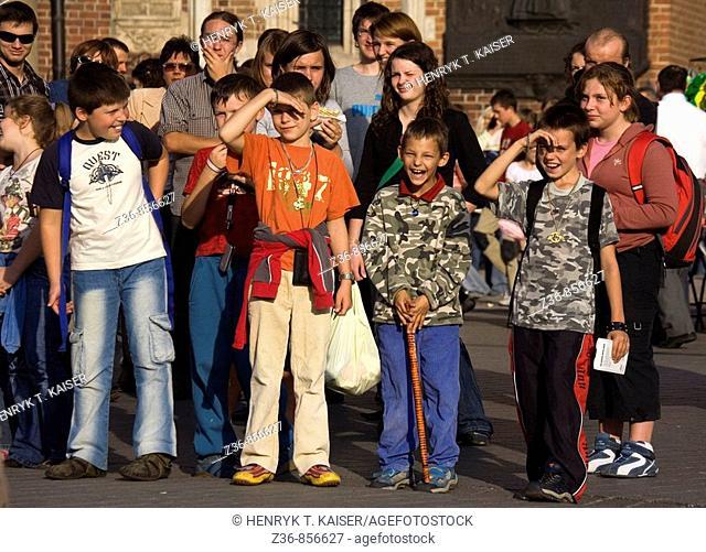Poland, Krakow, spectators at Main Market Square