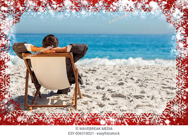 Young businessman relaxing on his sun lounger
