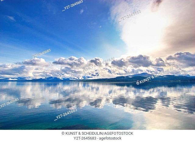 Mountains are reflected in Ofotfjorden near Evenes in northern Norway