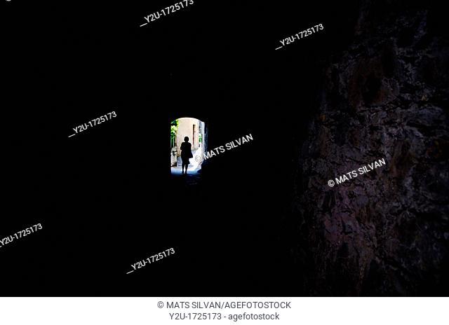 Woman walking in a dark alley in gandria
