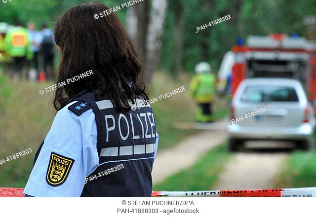 Rescue workers cordon off the site of a plane crash near Oberopfingen, Germany, 19 August 2013. A light aircraft carrying three people crahsed there between...