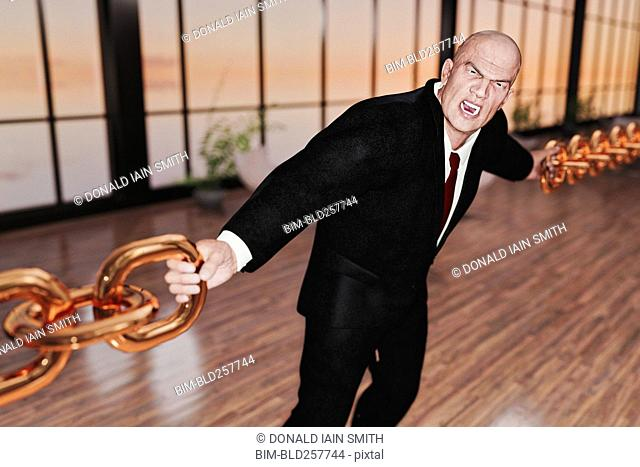 Businessman linking gold chains
