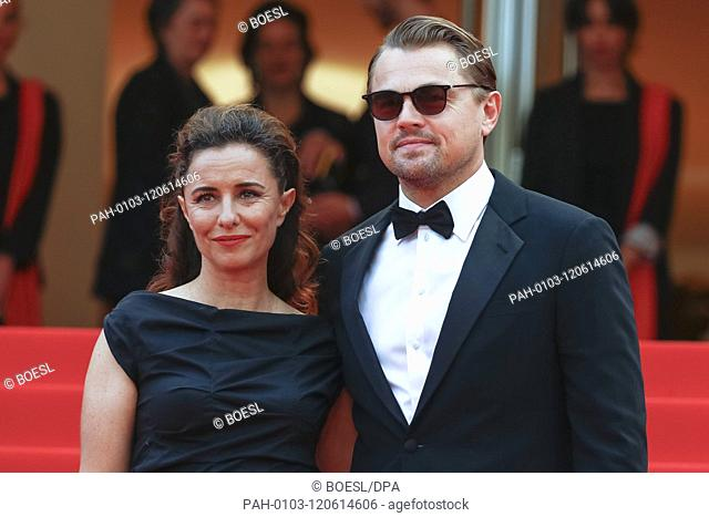 Leila Conners and Leonardo DiCaprio attend the premiere of 'Oh Mercy!' during the 72nd Cannes Film Festival at Palais des Festivals in Cannes, France