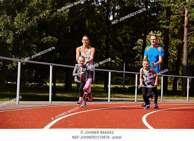 Family on running track