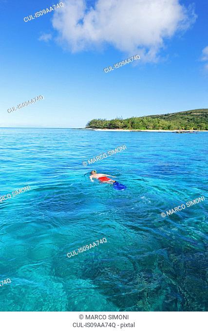 Man snorkelling, Drawaqa Island, Yasawa island group, Fiji, South Pacific