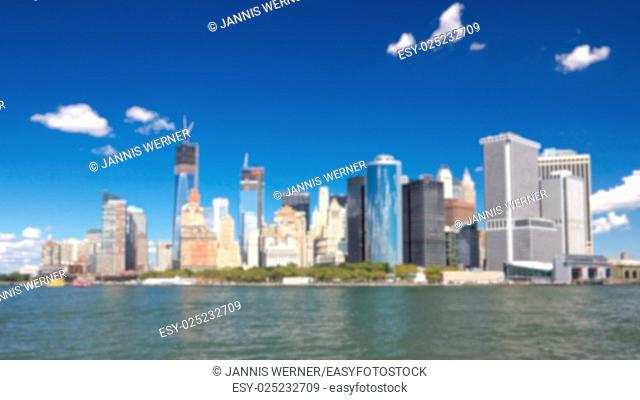 Blurred background of Southern tip of Manhattan with the Financial District as seen from a boat in New York harbor in New York, NY, USA