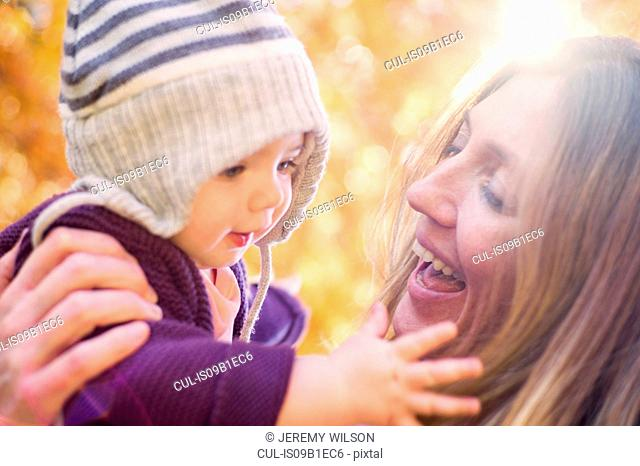 Smiling mother holding baby girl