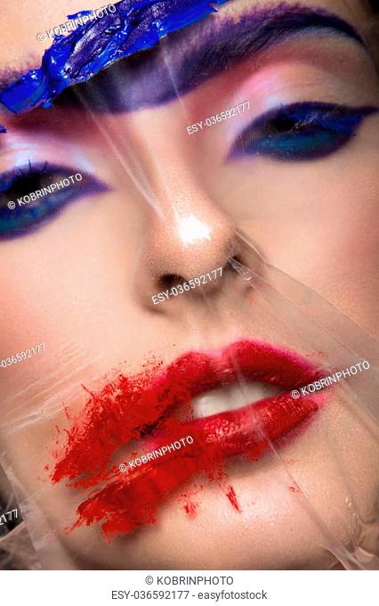 Fashion model with bright make-up art with a solid eyebrow. Creative image. Picture taken in the studio