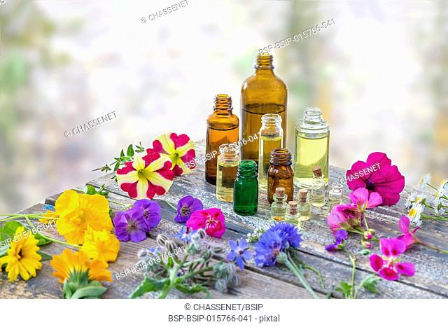 Essential oil and perfume from medicinal plant surrounded by petals