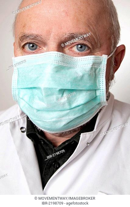 Doctor, physician wearing a white coat and a medical face mask