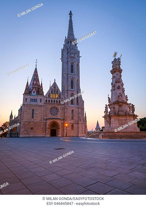 View of Trinity column and Matthias church in historic city centre of Budapest, Hungary.