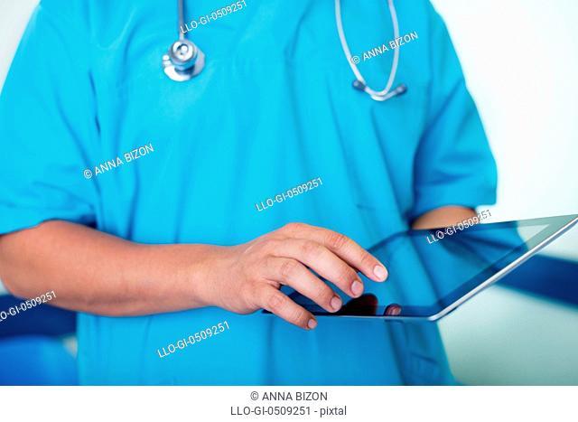 Doctor working using digital tablet Debica, Poland