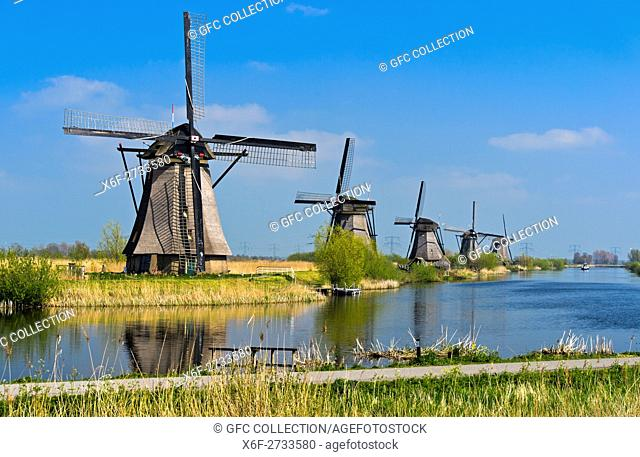 Dutch Windmill at a canal, Kinderdijk, Alblasserwaard polder, South Holland, Netherlands