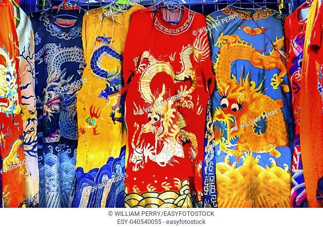 Blue Red Yellow Chinese Dragon Replica Silk Garments Robes Panjuan Flea Market Decorations Beijing China. Panjuan Flea Curio market has many fakes