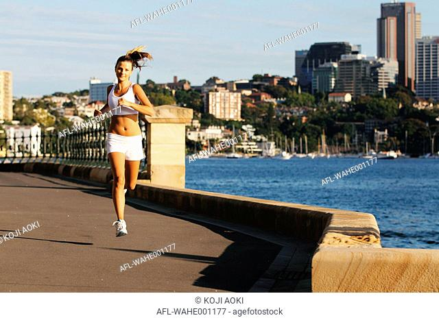 Young Woman Running Near Waterfront