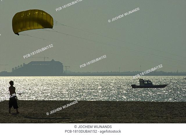 Dubai, kite surfing on Jum,eirah beach with the Palm in the background