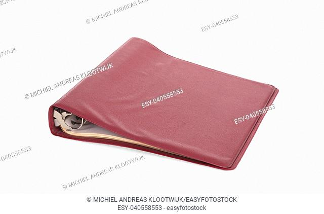 Old red ring binder isolated on a white background