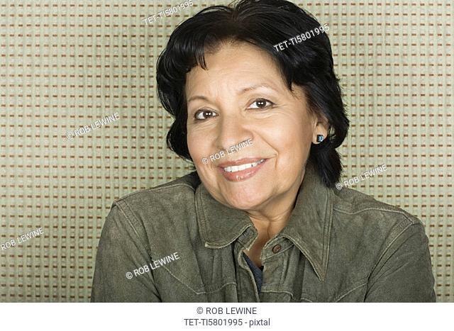 Studio portrait of senior woman smiling
