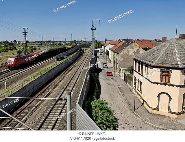 DEU , GERMANY : A cargo train of Deutsche Bahn AG is passing Bitterfeld , 07.07.2018 - Bitterfeld, Sachsen-Anhalt, Germany, 07/07/2018