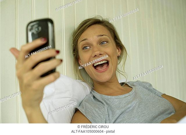 Woman smiling, taking selfie