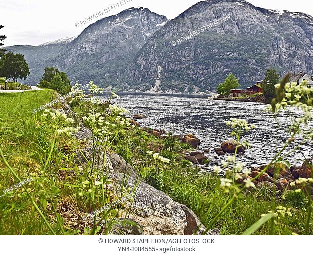 The Eio River empties into the Eid Fjord at the town of Eidfjord, Norway. The Eio river is only 1. 3 miles long and runs from Lake Eidfjord into the Eid Fjord...
