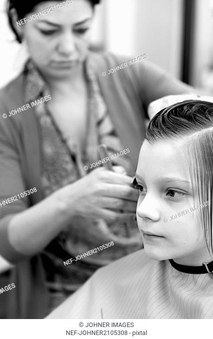 Boy at hairdresser