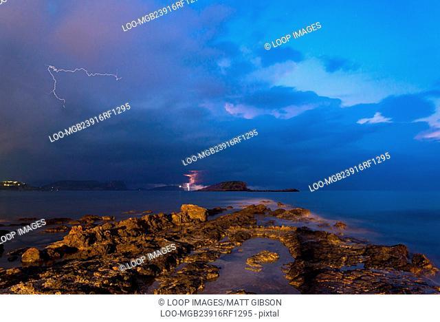 Lightning and storm landscape over beautiful rocky coastline in Mediterranean Sea