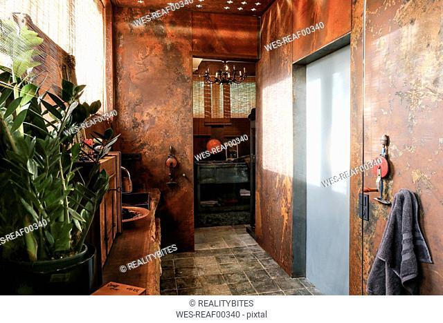 Bathroom with corten steel wall cladding