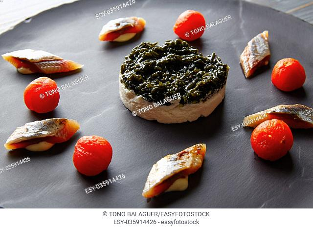 Bota sardine with white garlic pannacotta, codium and osmotized tomatoes