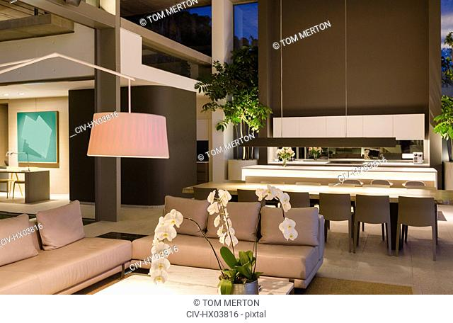 Illuminated modern, luxury home showcase interior living room and kitchen