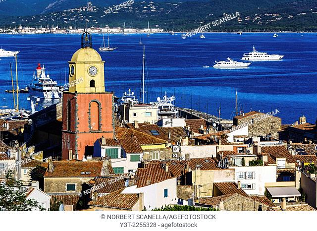 Europe, France, Var, Saint-Tropez. The parochial church in the village and the Gulf of Saint-Tropez