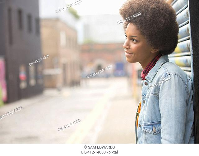 Pensive woman standing on city street