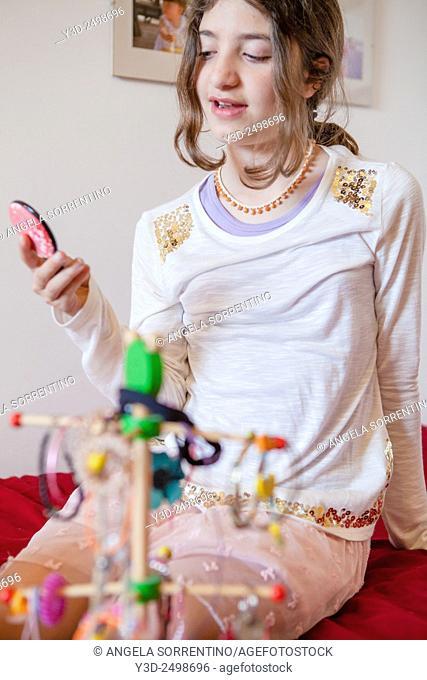 Teenage girl wearing lots of jewelry, Indoors