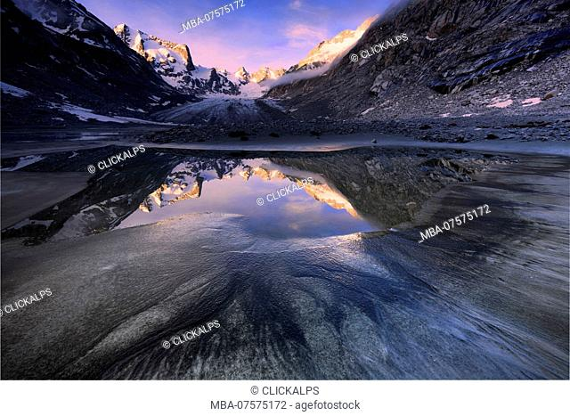 Sunrise from a pond at Forno Glacier, Forno Valley, Maloja Pass, Engadin, Graubünden, Switzerland, Europe