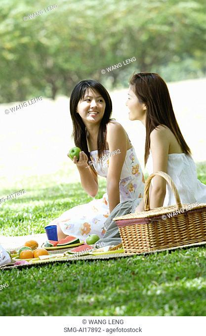 Two young women having a picnic