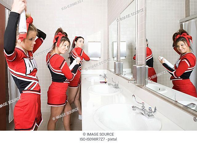 Cheerleaders in restroom