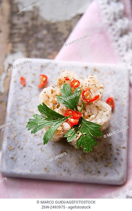 Introducing first taste of dish made of rice with parsley and chili