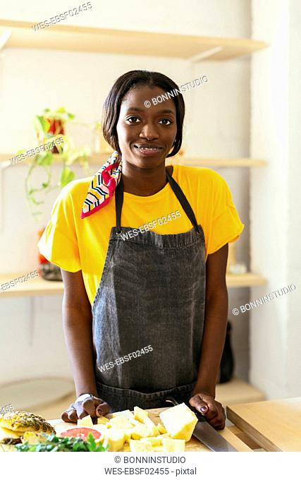 Portrait of smiling woman in kitchen