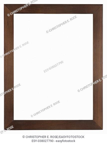 Empty picture frame isolated on white, portrait format in dark stained wood