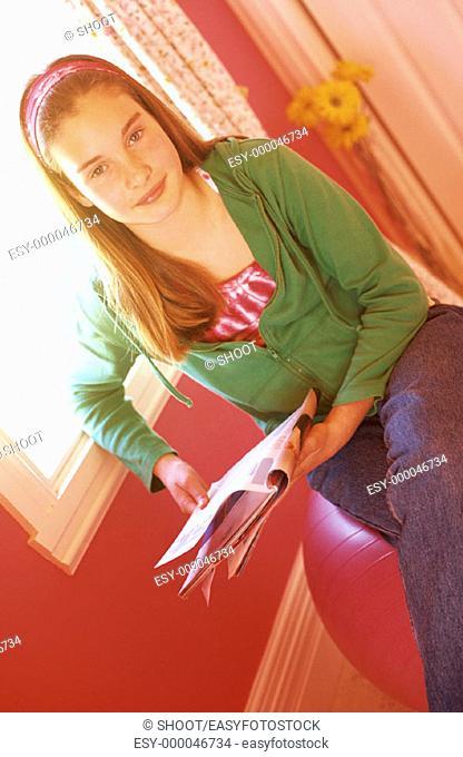 Girl with magazine, 11 yrs
