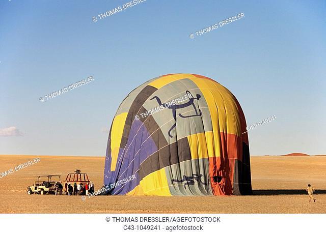 Namibia - After having landed, the hot-air ballonn quickly deflates  Namib Desert, NamibRand Nature Reserve, Namibia