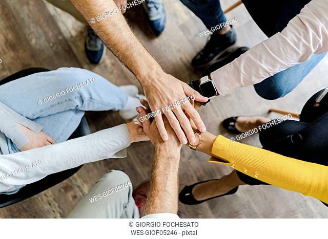 Close-up of business team stacking hands